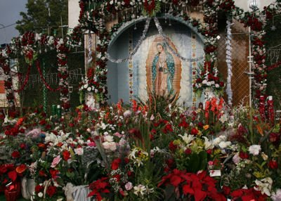 Los Angeles--A wall mural and shrine to the Virgin of Guadalupe near the El Mercado Market in East L.A. just south of Cesar Chavez Avenue.